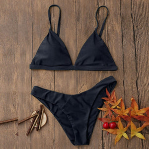 Our black Miami bikini looks really sophisticated; it has a triangular shape and is wire-free padded bikini top and a low waist bottom. The top has a clip and elastic bands in the back that makes this set fit your body perfectly.