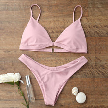 Our pink Miami bikini looks really sophisticated; it has a triangular shape and is wire-free padded bikini top and a low waist bottom. The top has a clip and elastic bands in the back that makes this set fit your body perfectly.