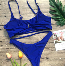 This beautiful blue bikini set's bottom has a Brazilian high waist cut, with a decorative sting surrounding your waste in a very sensual way. The top is padded and wire-free, and it also has a unique cut with an additional string underneath thee breasts giving your body a beautiful shape. It is made of 82% polyester and 18% spandex.