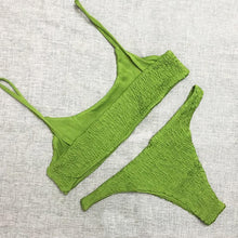 Trendy green bandeau bikini set with decorative smock, made of polyester and cotton.