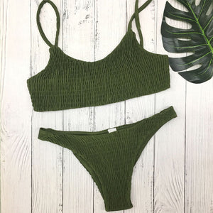 Trendy army green bandeau bikini set with decorative smock, made of polyester and cotton.
