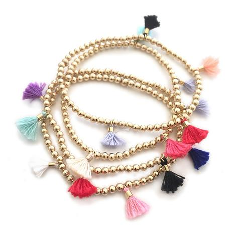 gold and tassels bracelet