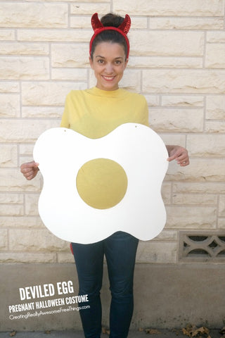 woman wearing a deviled egg costume pregnant