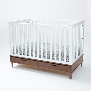 White Crib on Walnut Base