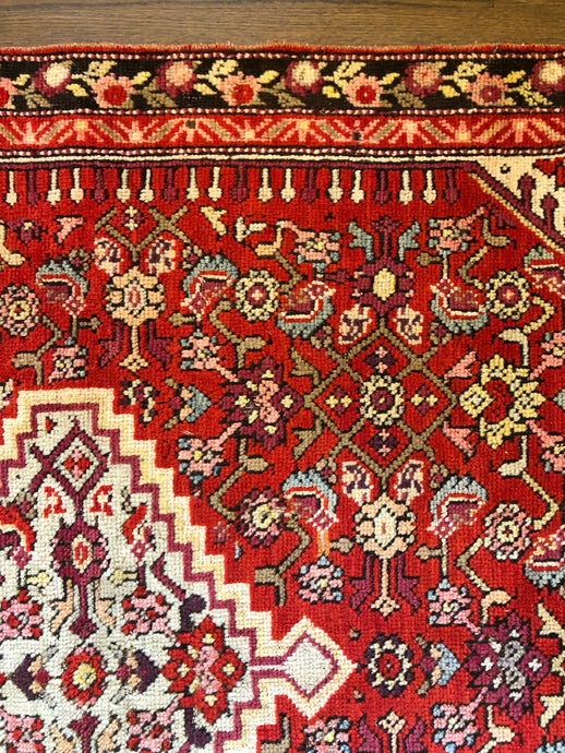 Hashem, Vintage Persian rug with cadmium red