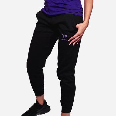 black unisex joggers with purple cow logo