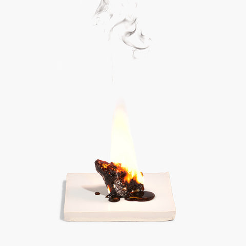 Breu Branco burning on handcrafted tile.