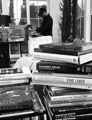 Francisco Costa in his home in Bellport, New York surrounded by books.