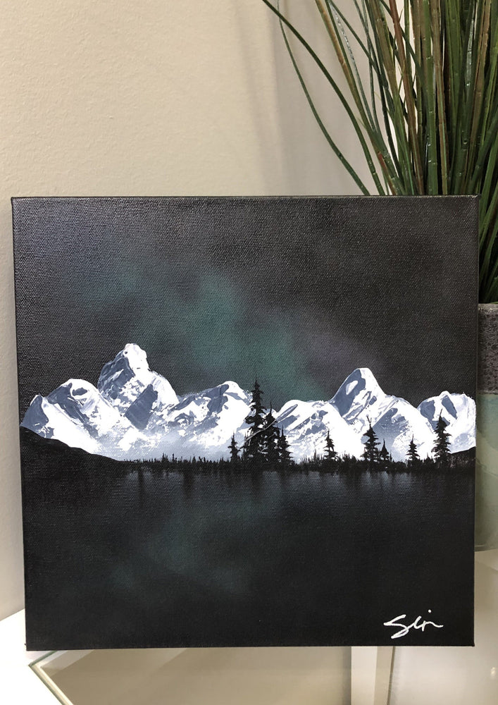 Green night sky with mountains