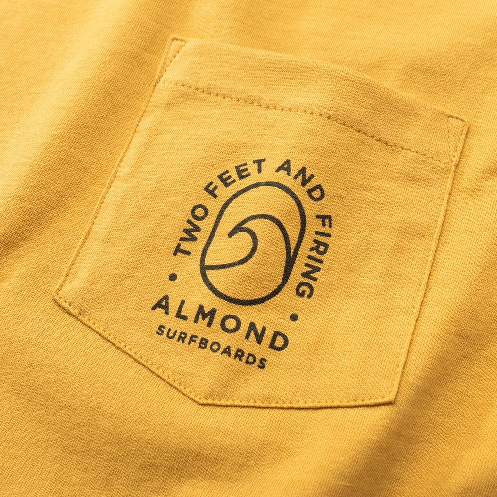 Almond Surfboards Wave Badge Pocket Tee - Mustard