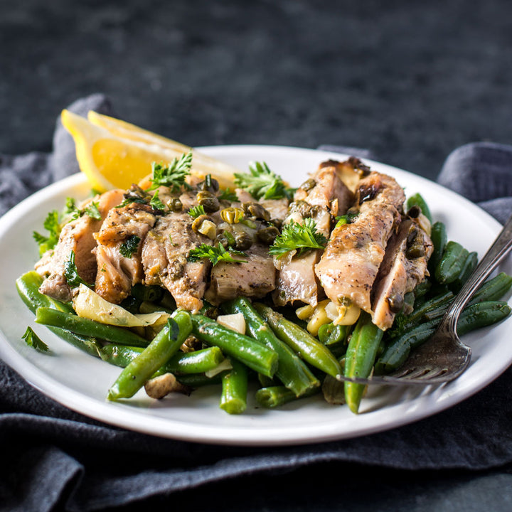 The Lemon Artichoke Chicken from paleo meal delivery company, Balanced Bites Meals, features Lemon Chicken, capers and fresh green beans.