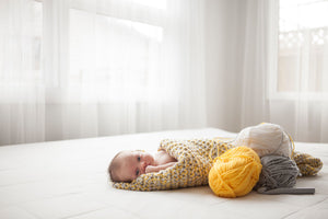 Yellow and grey crochet baby blanket from Design by AW