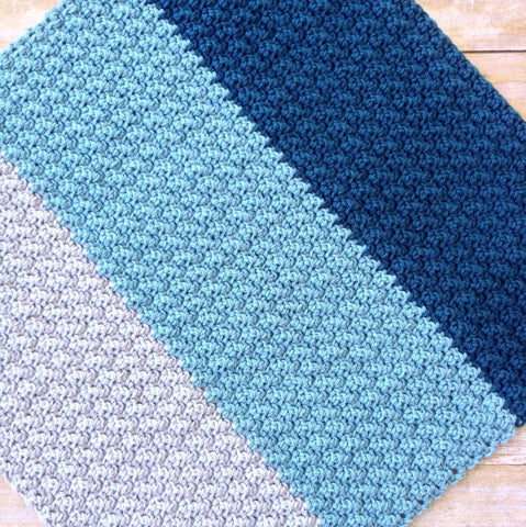 modern handmade crochet baby blanket in blue and grey color block design