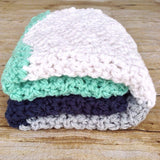 chunky crochet handmade baby blanket in navy, mint green, grey amd white chevron stripes from Design by AW