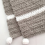 new baby gift, grey and white chunky crochet handmade blanket with pom poms from Design by aw