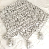 gender neutral baby blanket, crocheted in grey with corner tassels