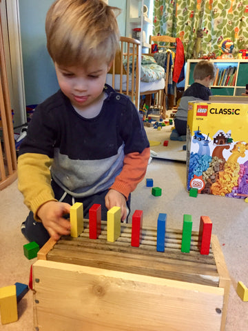 stacking wooden blocks, improve dexterity