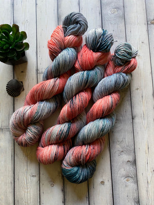 pink and blue gray yarn