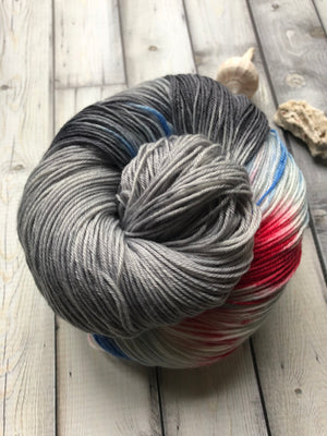gray blue red black and white yarn