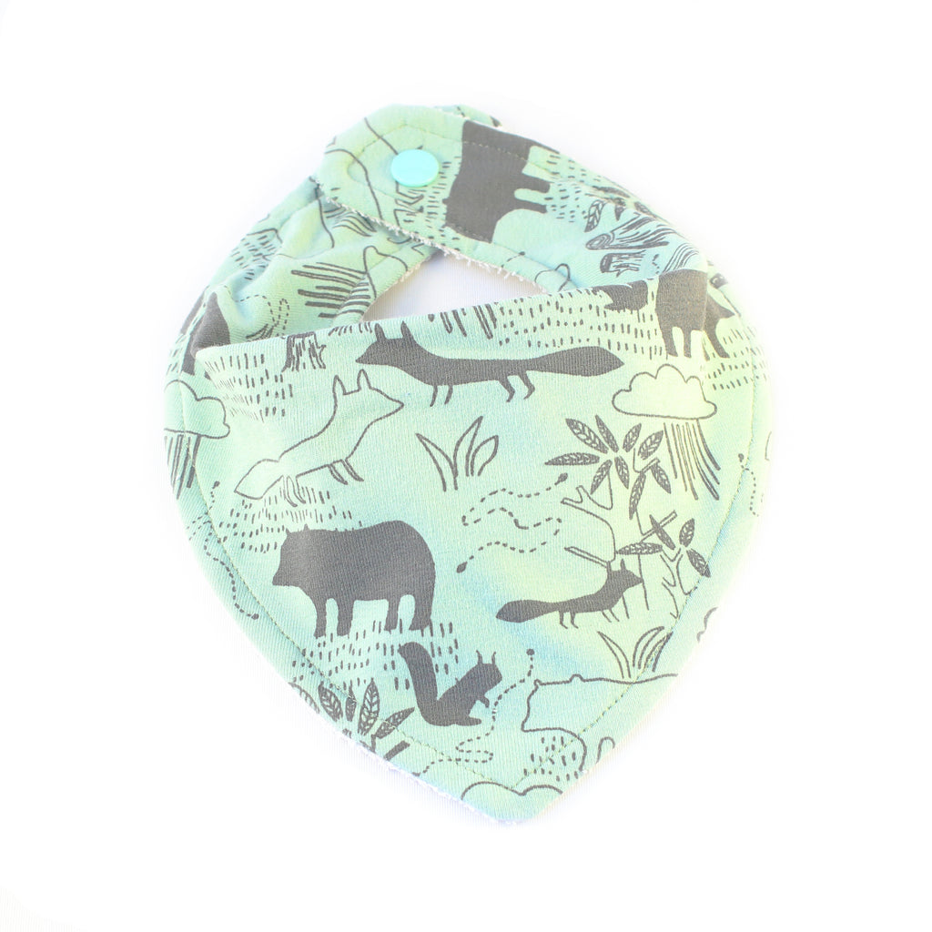 light green mint drool bib with woodland creatures