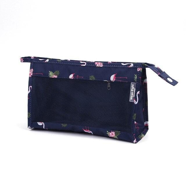 Trousse de toilette transparente bleu flamant rose