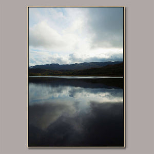 Mirrored sky Framed Canvas