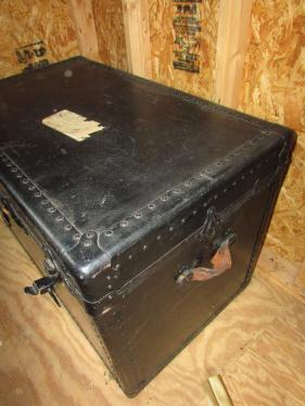 Antique travel trunk with shelf