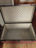 Antique travel trunk with rollers