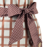 Woman apron, classic straight cut. Plaid of light green and brown.  Belt and pockets are brown with white dots.