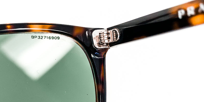 how to authenticate prada sunglasses marks on lenses