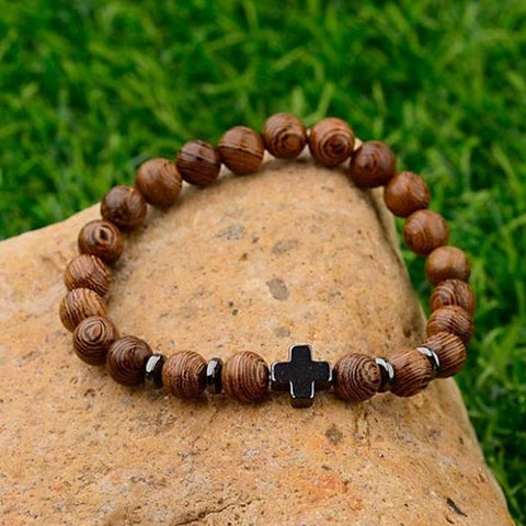 Heman Bracelet with wooden beads and small black steel cross