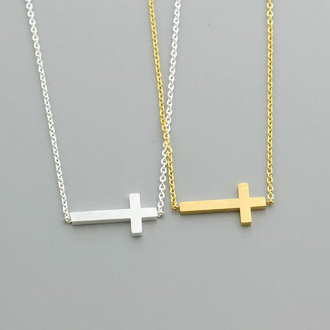 Saphira Necklace in gold and silver with lying cross pendant