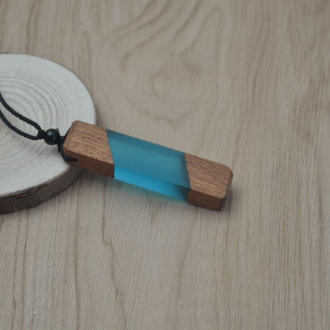 Starfall Necklace in light blue raisin with wood elements