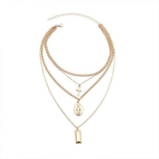 Naemi Necklace in gold with holy pendants