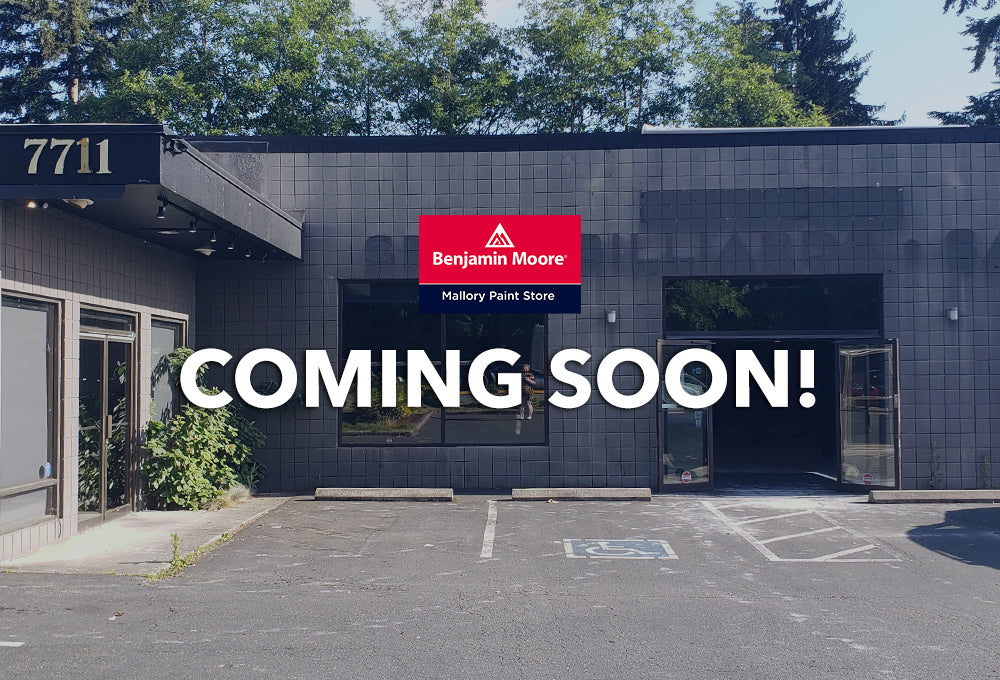 "Exterior of building where new Mallory Paint Store Shoreline location is moving to, with the words ""Coming Soon!"" and the Mallory Paint Store red and blue logo."