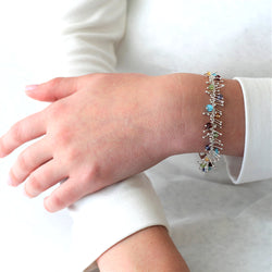 Delicate Feather Bracelet in Silver: Multi-Gem