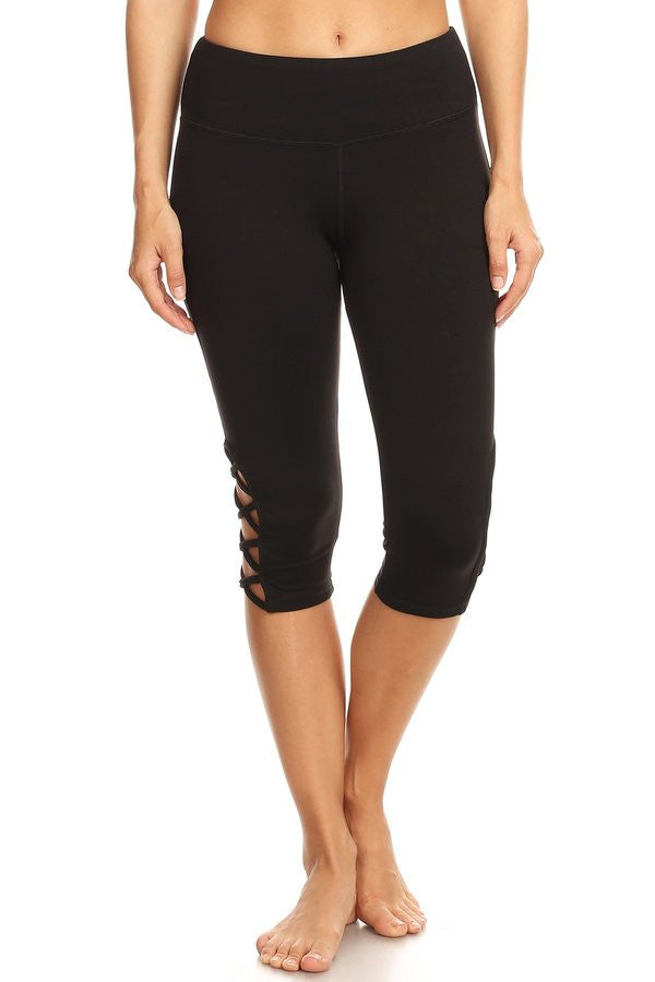 Black hi-rise Capri with a side crisscross strap cutout Leggings