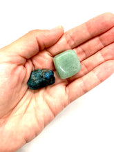 Load image into Gallery viewer, Enhance the love you have, give, and receive with this Love & Expression set. Included in this set is a green aventurine stone representing love and a teal blue apatite stone for expression. The aventurine stone measures approximately 1 inch and the apatite stone approximately 3/4 of an inch. All earthlings (stones, gemstones, and crystals) carry energy & vibrations and can be worn (or carried) on your body, displayed around the interior &/or exterior of your home, at your office, or in your car.