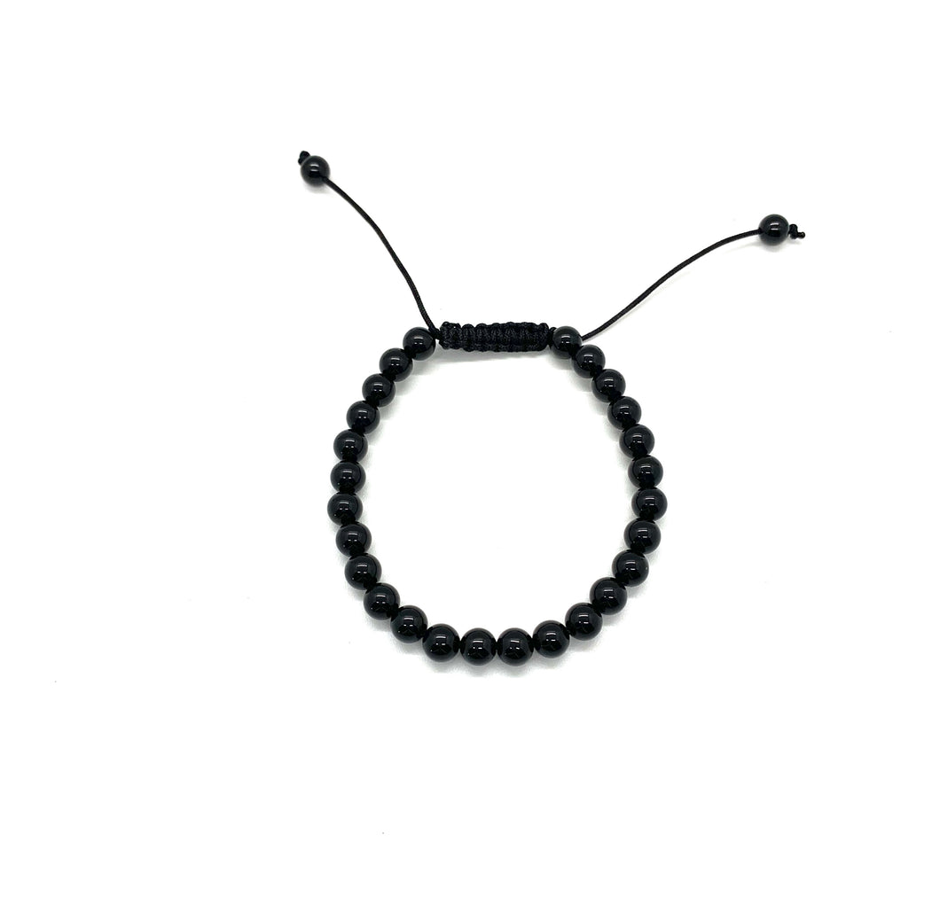 Onyx is a shiny black stone that inspires one to step into their personal power and is most associated with the root chakra. Bracelet materials include 6mm onyx stones on an adjustable string that measures 6-9 inches to fit men, women & children. One size fits most.