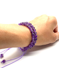 Load image into Gallery viewer, Amethyst is a purple stone that promotes peace, healing & transformation and is most associated with the third eye chakra. Bracelet materials include 6mm amethyst stones on adjustable string that measures 6-9 inches to fit men, women & children. Two bracelets come in this set. One size fits most.