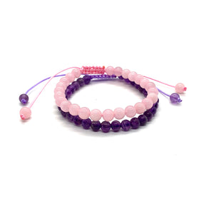 Wear these bracelets together & invite peace and love into your life! Amethyst is a purple stone that promotes peace and rose quartz is a soft pink stone that enhances love. Bracelet materials include 6mm amethyst & rose quartz stones on adjustable string that measures 6-9 inches to fit men, women & children. Two bracelets come in this set.  One size fits most.