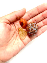 Load image into Gallery viewer, If you are feeling unstable or insecure in any aspect of your life, this lower chakra trio will help you root to rise. Included in this trio is a red agate stone, a carnelian stone, and a citrine stone-all of which carry high vibrational energy on their own, but get supercharged when combined.   The agate stone measures approximately 1 inch, the carnelian approximately 1/2 an inch, and the citrine stone approximately 3/4 of an inch.