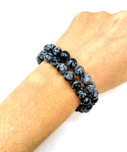 Load image into Gallery viewer, Snowflake Obsidian is a black & white speckled stone that provides serenity & clarity. Bracelet materials include 8mm snowflake obsidian stones on an elastic cord.  Two bracelets included in this set. Custom sizing is available by Contacting Us.