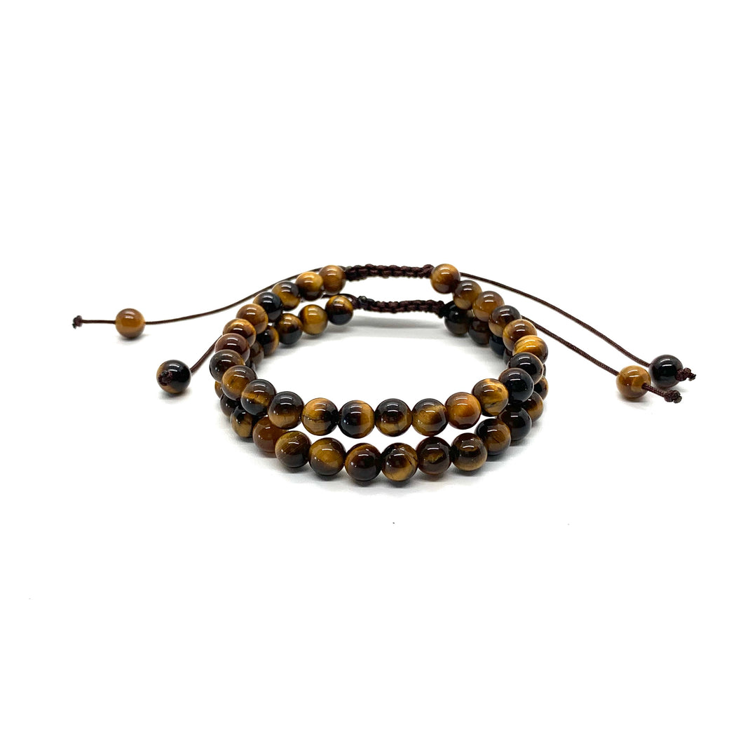 Tiger's Eye is a brown marbleized stone that offers protection to the wearer and is most associated with the solar plexus chakra. Bracelet materials include 6mm tiger's eye stones on adjustable string that measures 6-9 inches to fit men, women & children. Two bracelets come in this set. One size fits most.