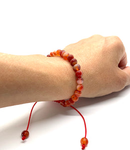Carnelian is a reddish-orange stone that promotes courage, confidence & creativity and is most associated with the sacral chakra. Bracelet materials include 6mm carnelian stones on an adjustable string that measures 6-9 inches to fit men, women & children. One size fits most.