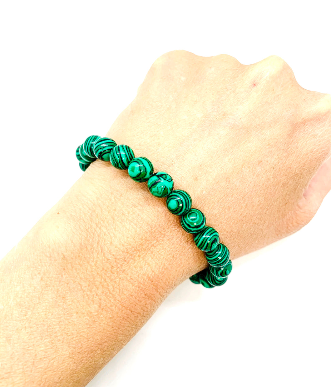 Malachite is a swirling emerald green stone that acts as a personal cheerleader encouraging self-worth, commitment, willpower, & forgiveness.  It is also most associated with the heart chakra. Bracelet materials include 8mm malachite stones on an elastic cord. Custom sizing is available by Contacting Us.