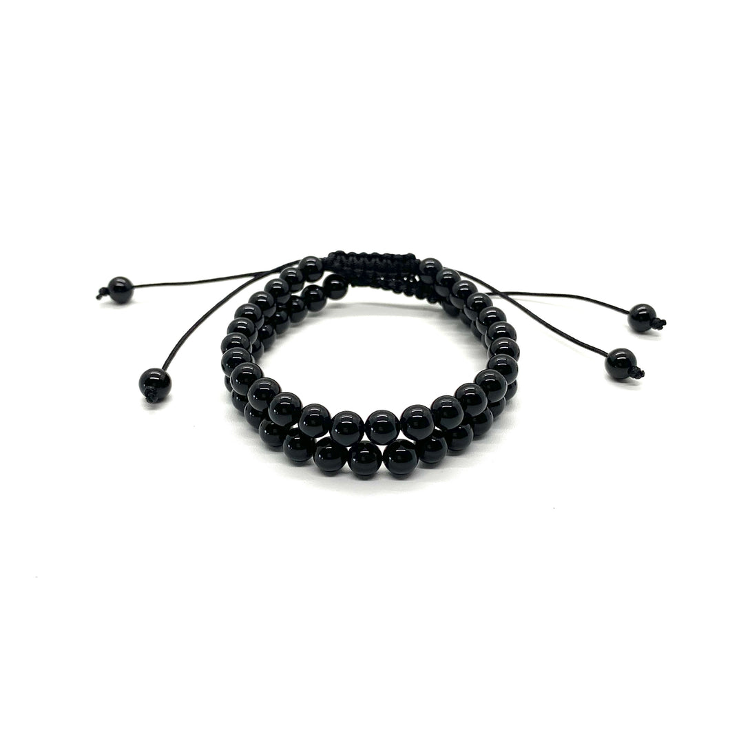 Onyx is a shiny black stone that inspires one to step into their personal power and is most associated with the root chakra. Bracelet materials include 6mm onyx stones on adjustable string that measures 6-9 inches to fit men, women & children. Two bracelets come in this set. One size fits most.