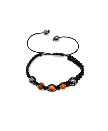 Ignite your nurturing essence with this sparkle jasper & hematite macrame bracelet. Bracelet materials include 10mm sparkle jasper & hematite stones on an adjustable string that measures 6-9 inches to fit men, women & children. One size fits most.