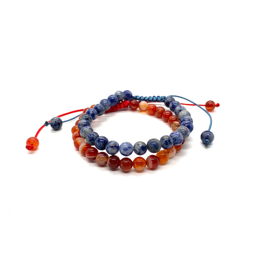 Wear these bracelets together so you can be courageous and expressive! Carnelian is a marbleized orange stone that ignites courage and sodalite is a blue and white stone that promotes communication and expression. Bracelet materials include 6mm carnelian & sodalite stones on adjustable string that measures 6-9 inches to fit men, women & children. Two bracelets come in this set.  One size fits most.