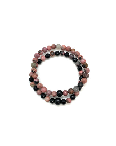 Rhodonite is a pink, black & white stone that helps with letting go and heartbreak and in turn helps with setting boundaries, compassion (for oneself and others), and stabilizing. It is also most associated with the root chakra. Bracelet materials include 6mm rhodonite stones on an elastic cord. Two bracelets included in this set that measures 7 inches each.  Custom sizing is available by Contacting Us.